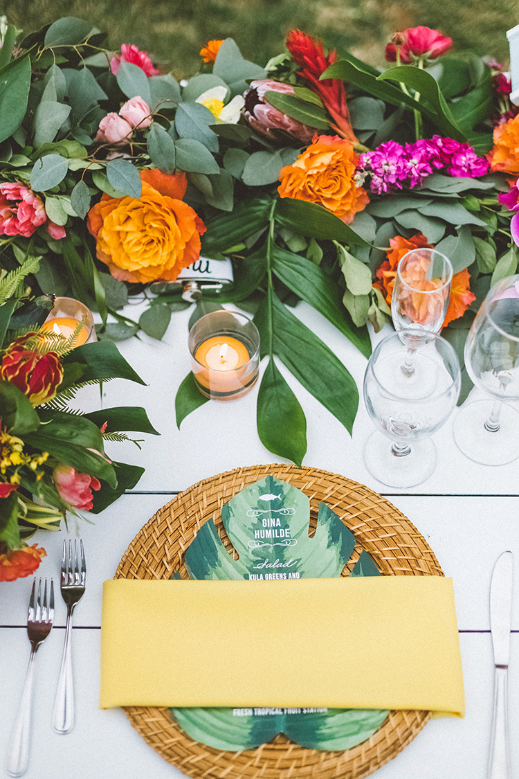 tropcial wedding tablescapes with bright flowers - http://ruffledblog.com/bright-colorful-destination-wedding-in-maui