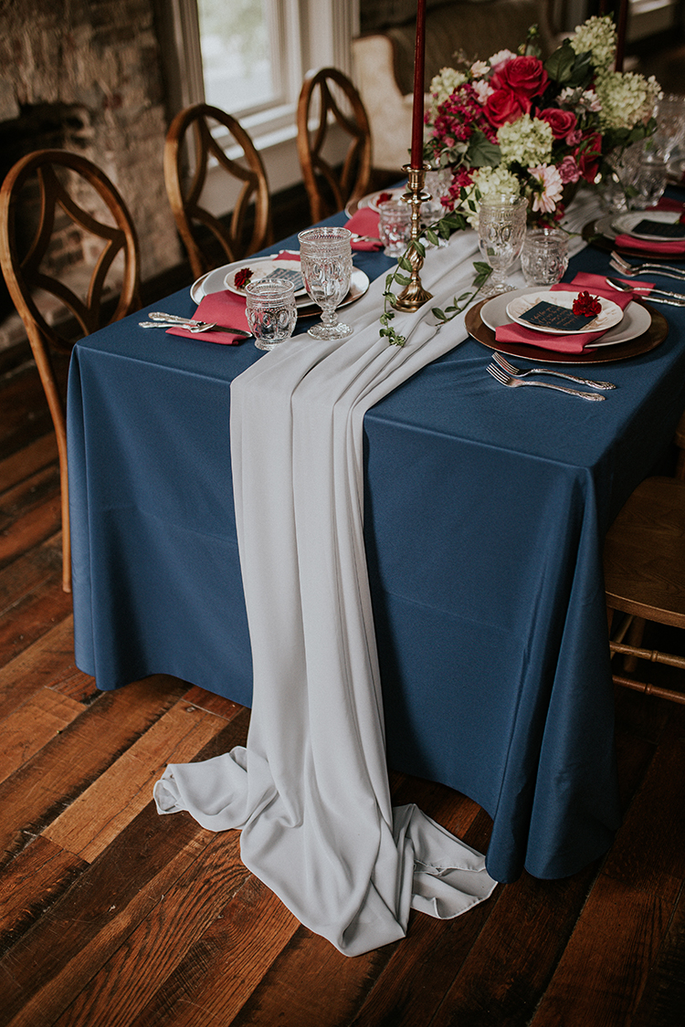 blue table runners - http://ruffledblog.com/artist-inspired-wedding-ideas-with-oxblood-and-navy