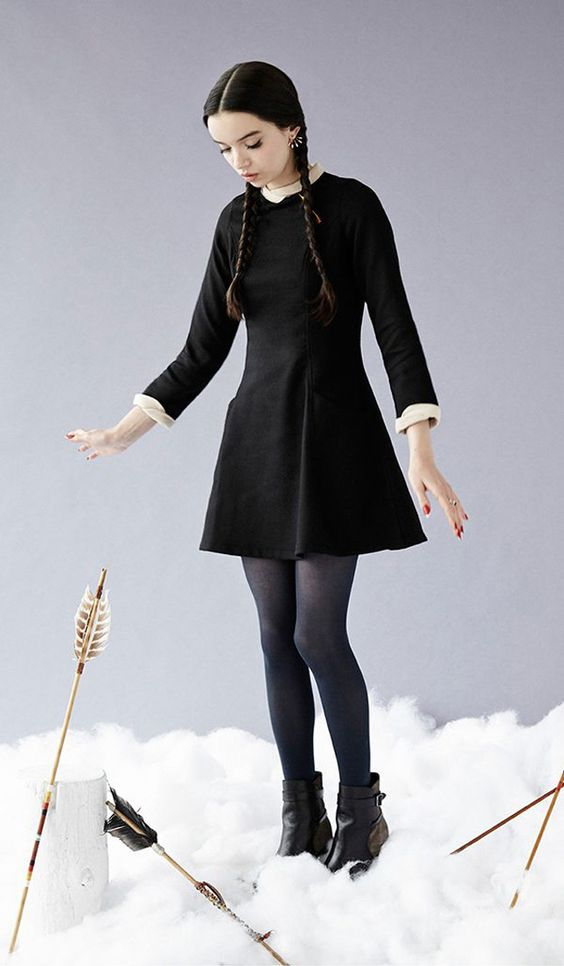 Wednesday Addams costume with a little black dress, a white shirt, blue tights and black booties