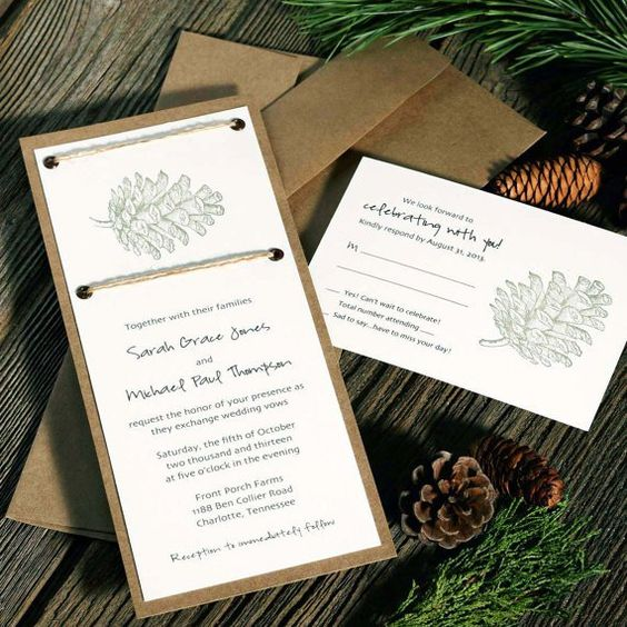 kraft paper, pinecones and twine wedding inivtations for a cozy rustic winter wedding