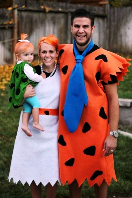 Fred And Wilma Flintstone costumes for the parents, Bamm Bamm Rubble costume for the kid