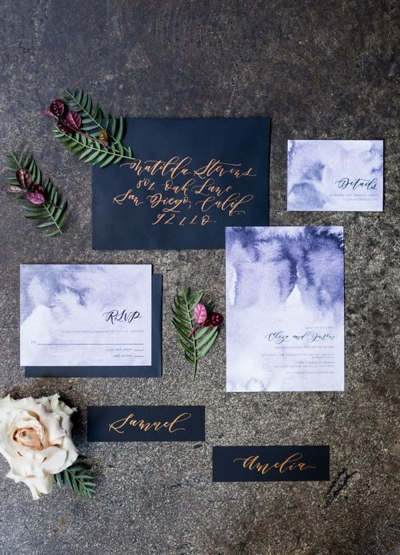 black envelopes and watercolor purple wedding invites with calligraphy for a dark-colored wedding