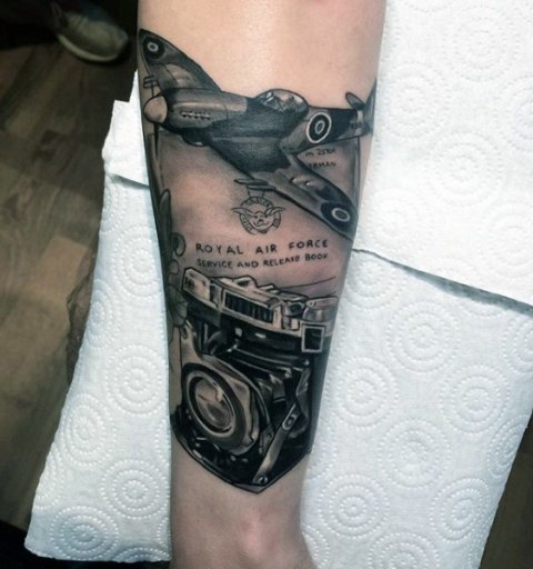 Plane and camera tattoo idea on the forearm