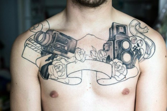 Two cameras and flowers tattoo on the chest