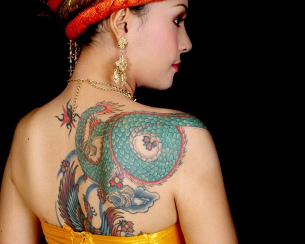 Colorful tattoo on the back and shoulder