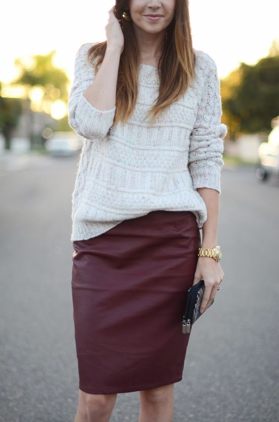 a white sweater and a burgundy leather pencil skirt create a comfy and girlish fall look