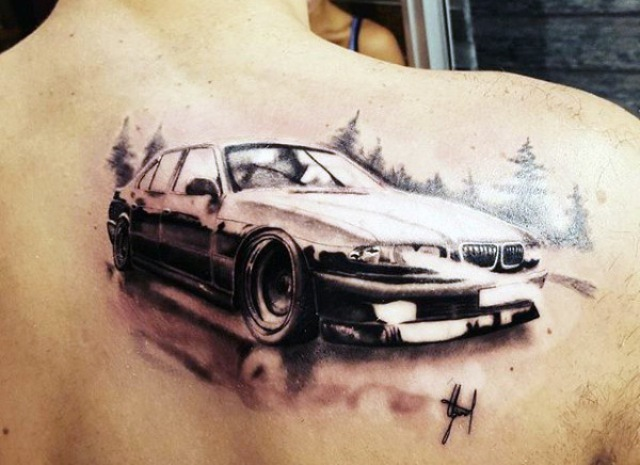 Car and forest tattoo on the back