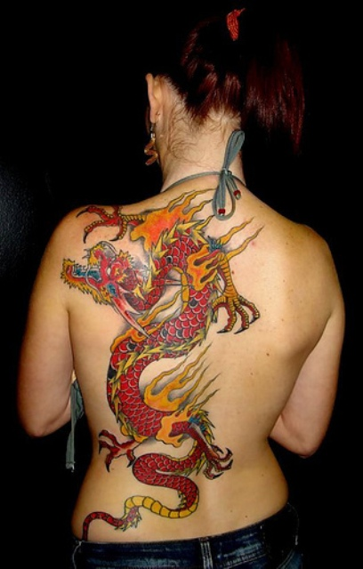 Red dragon and flame tattoo on the back