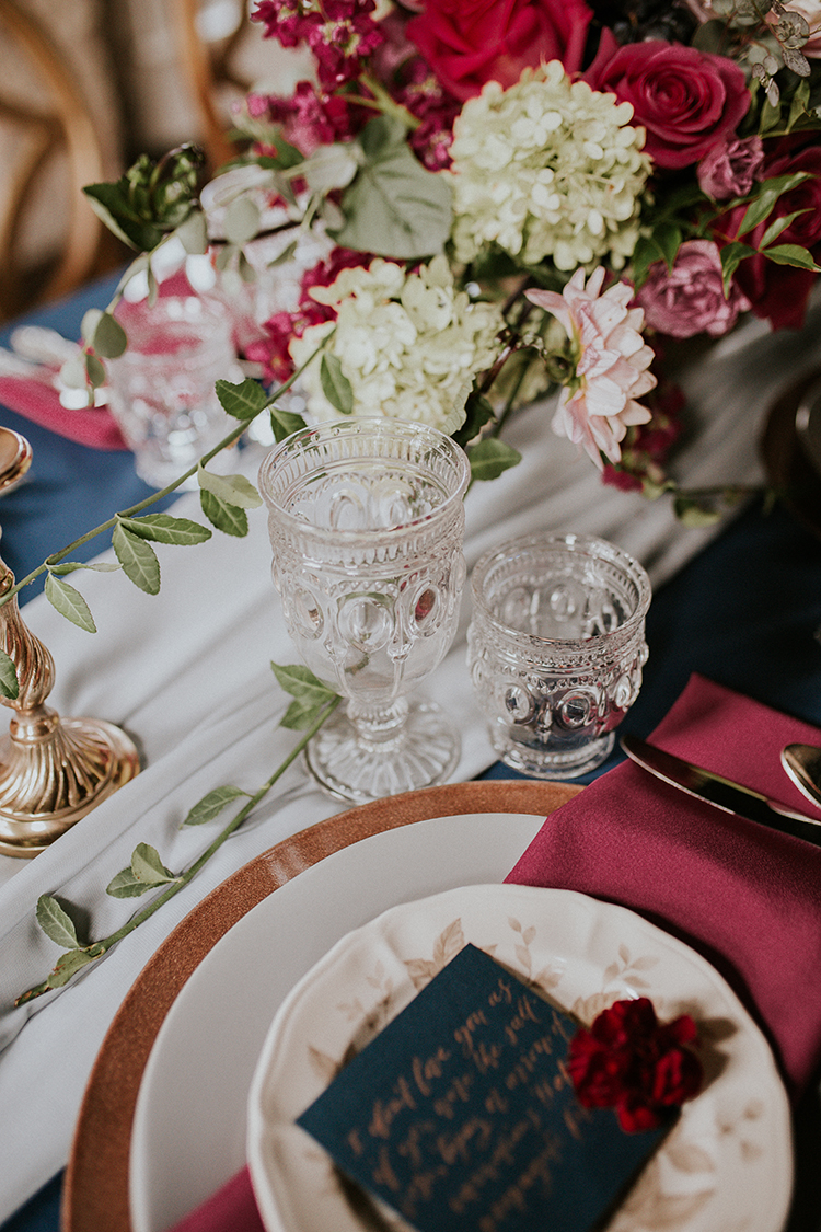 vintage inspired wedding glasses - http://ruffledblog.com/artist-inspired-wedding-ideas-with-oxblood-and-navy