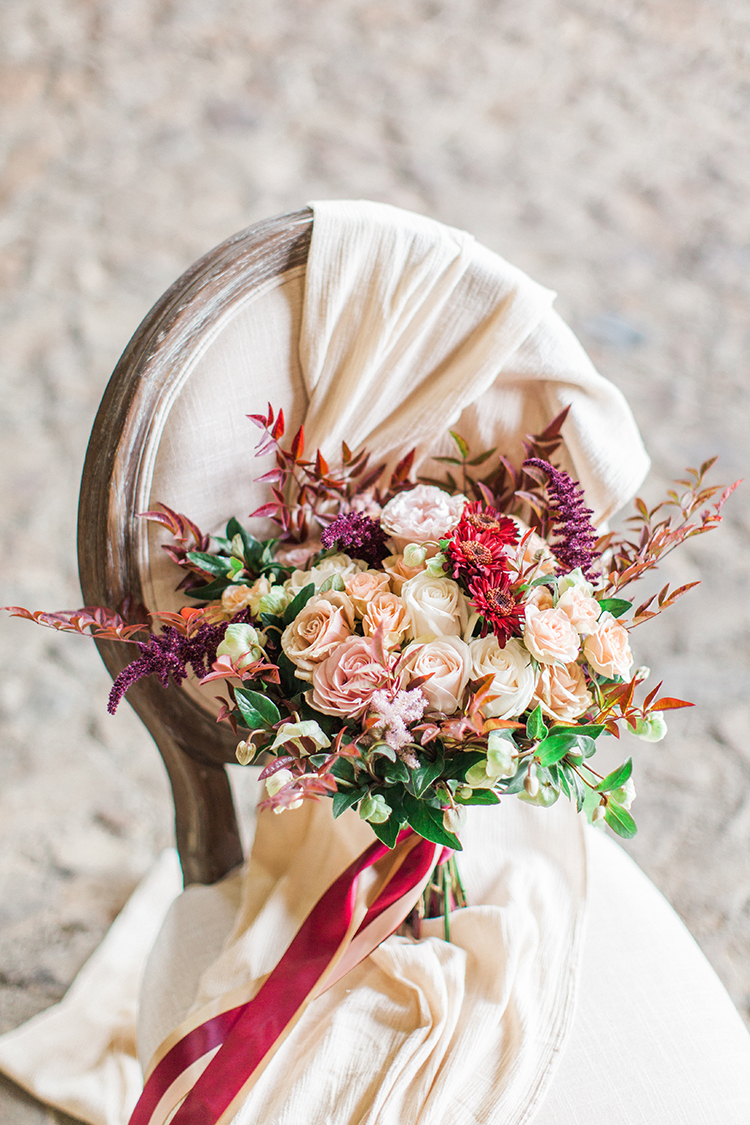dramatic fall wedding bouquets - http://ruffledblog.com/winery-vow-renewal-inspiration-with-autumn-leaves