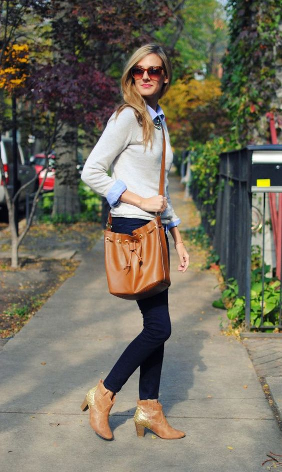 navy jeans, a neutral jumper over a blue shirt, amber booties and a bag