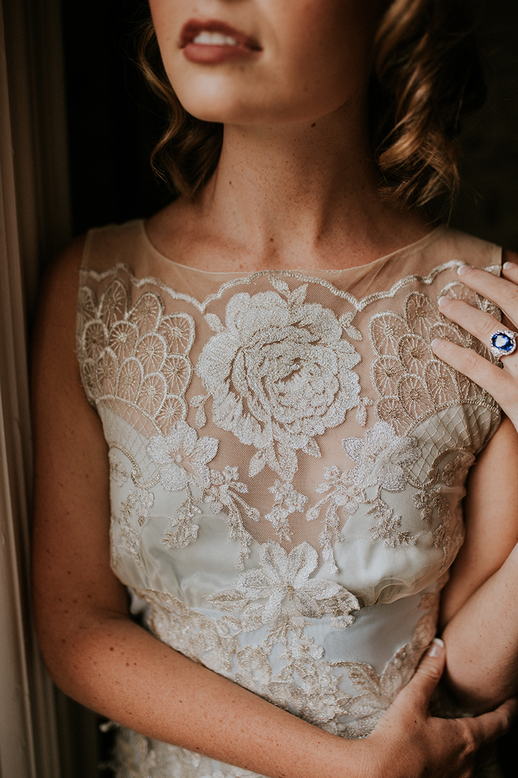 lace Claire Pettibone wedding dresses - http://ruffledblog.com/artist-inspired-wedding-ideas-with-oxblood-and-navy