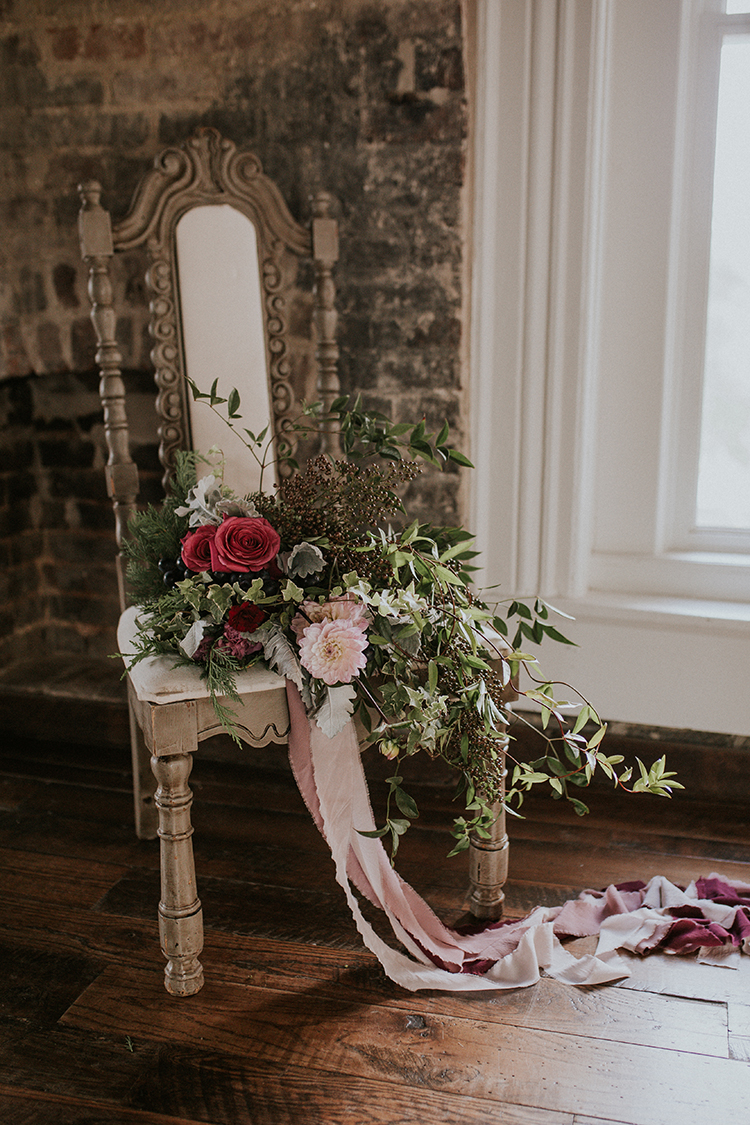 wedding flowers - http://ruffledblog.com/artist-inspired-wedding-ideas-with-oxblood-and-navy