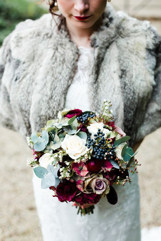 white and lavender roses, privet berries, fuchsia blooms, pale greenery for a cool winter look