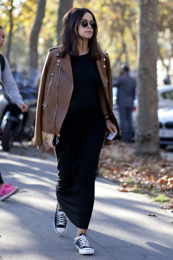 a black maxi dress, a cognac colored leather jacket and black Converse for a chic feminine look