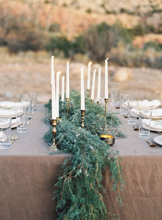 a textural greenery table runner looks very elegant and chic with gilded touches on the table