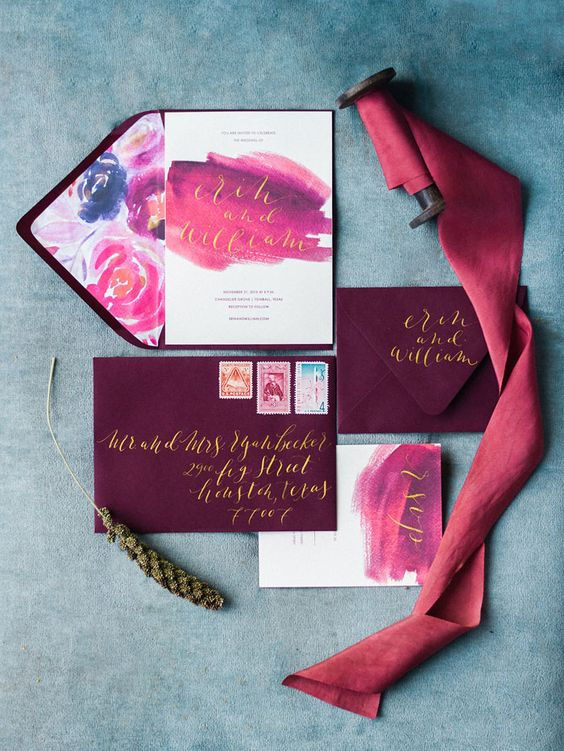 plum-colored envelopes, pink and purple watercolor wedding invites with gold calligraphy