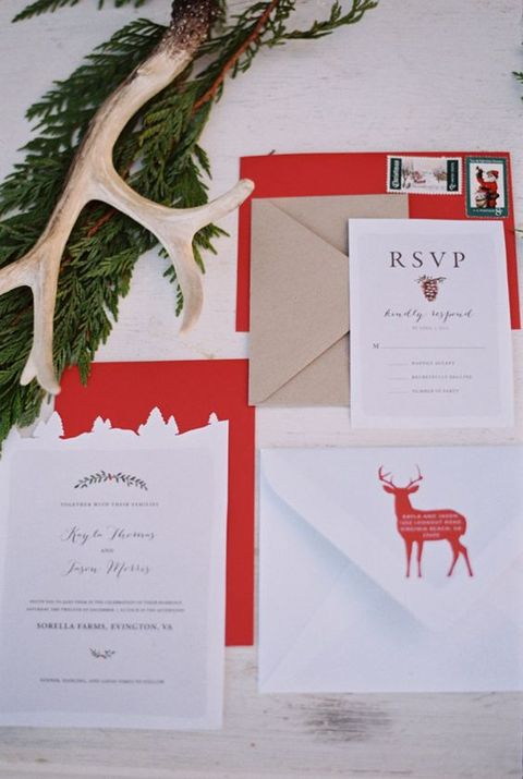 a chic traditional Christmas invitation suite with kraft paper, deer and lots of red for a bold and homey wedding
