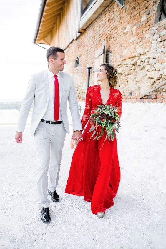 a red wedding gown with a lace bodice and sleeves and a plain skirt for a Christmas bride