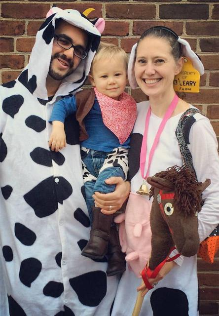 cow costumes for the parents, and a cowboy costume for the son