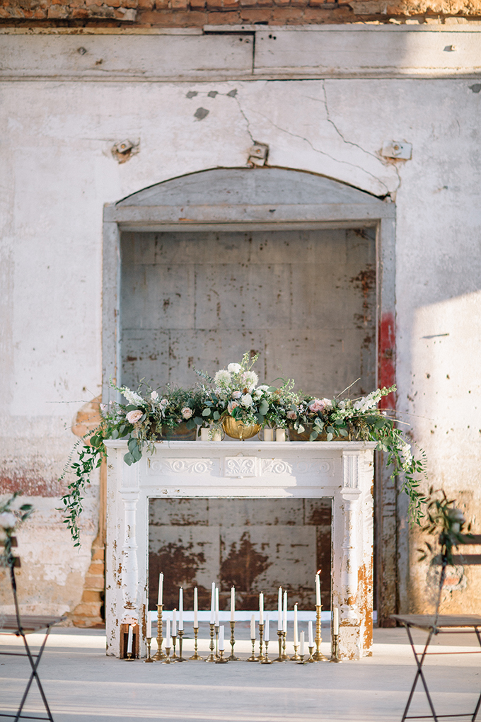 The fireplace looked refined and contrasted the industrial space very much, I love the lush blooms and lots of candles