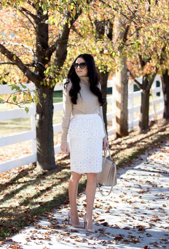 a white lace pencil skirt, a neutral cowl neck sweater, nude heels and a bag