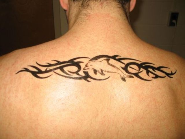 Simple dolphin tattoo on the back