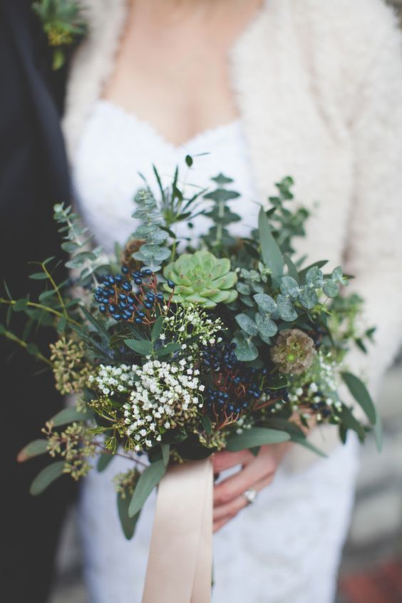 a greenery bouquet with eucalyptus, succulents, privet berries, small white blooms and blush ribbon for a woodland bride