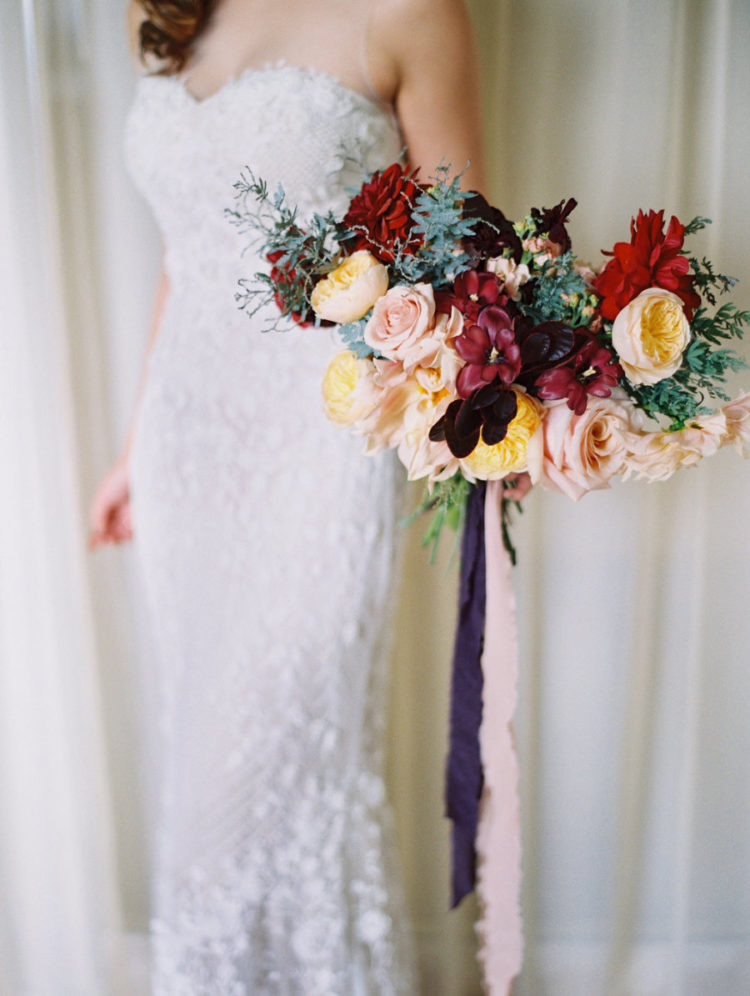 The bridal bouquet was a bold one, with red, dark plum and yellow blooms