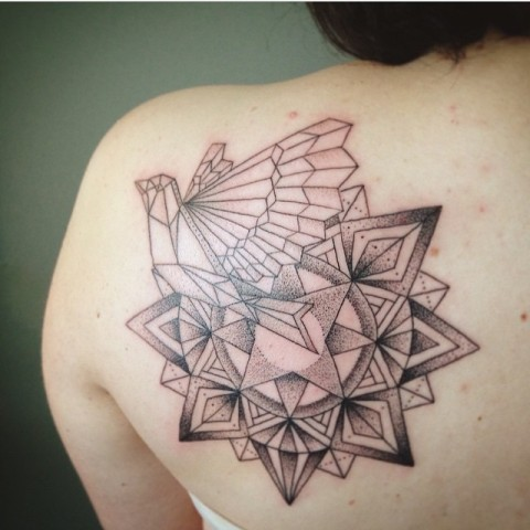 Geometric dove tattoo on the shoulder