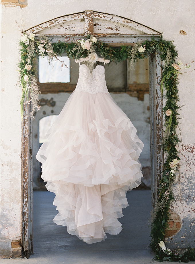 The wedding dress was with a textural lace bodice and ruffled blush skirt