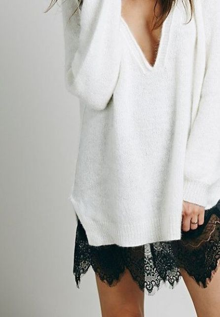 a black lace skirt and a white oversized deep V-neckline sweater for a sexy look
