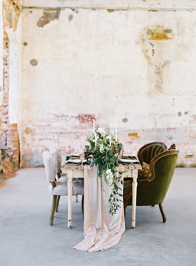 The wedding reception was done with refined upholstered chairs and a blush sequin table runner and textural greenery runners