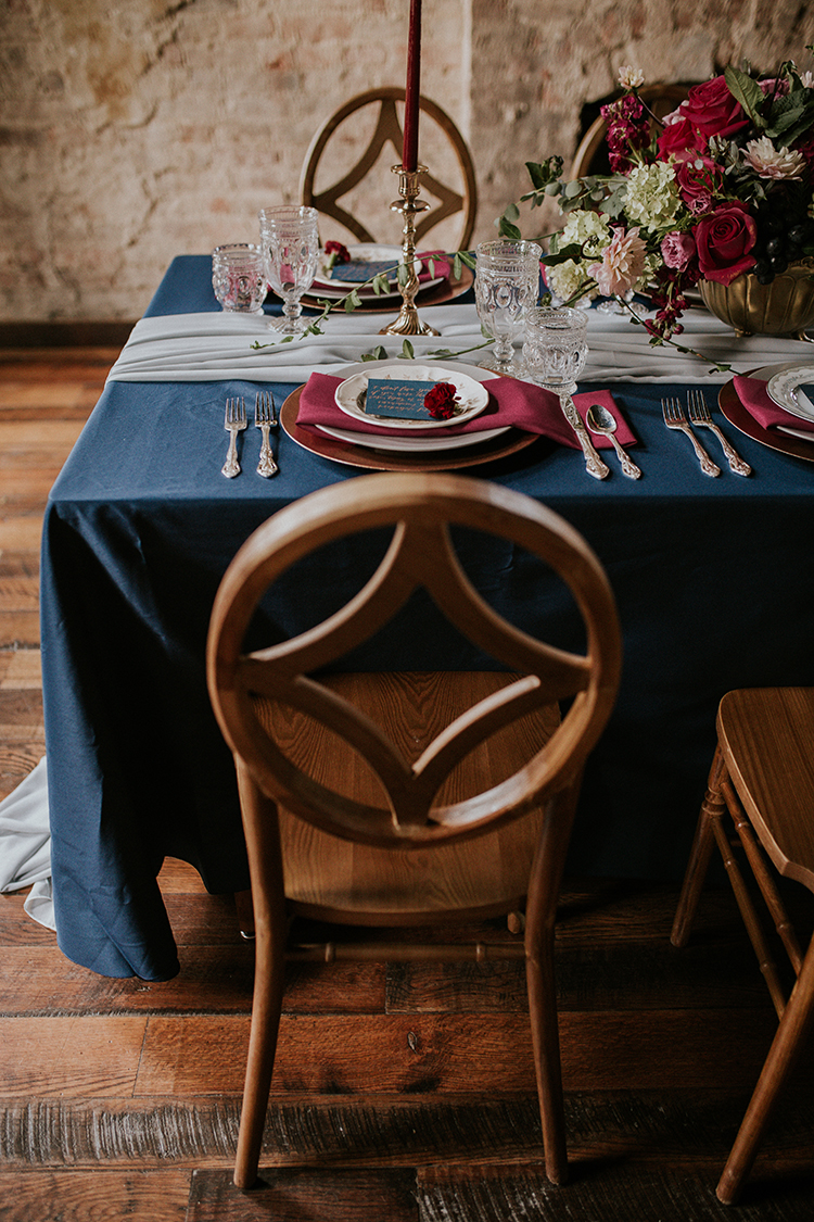 wedding chairs for a geometric wedding - http://ruffledblog.com/artist-inspired-wedding-ideas-with-oxblood-and-navy