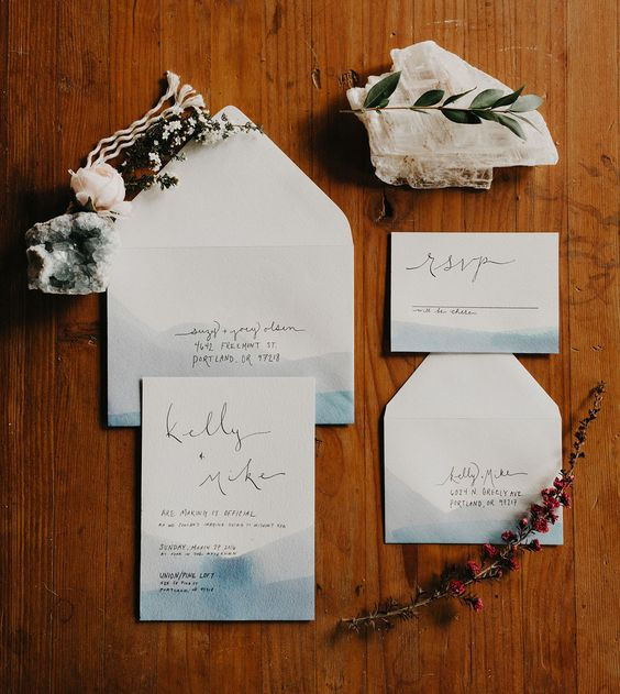 coastal watercolor blue wedding invitations with black letters look minimal and stylish
