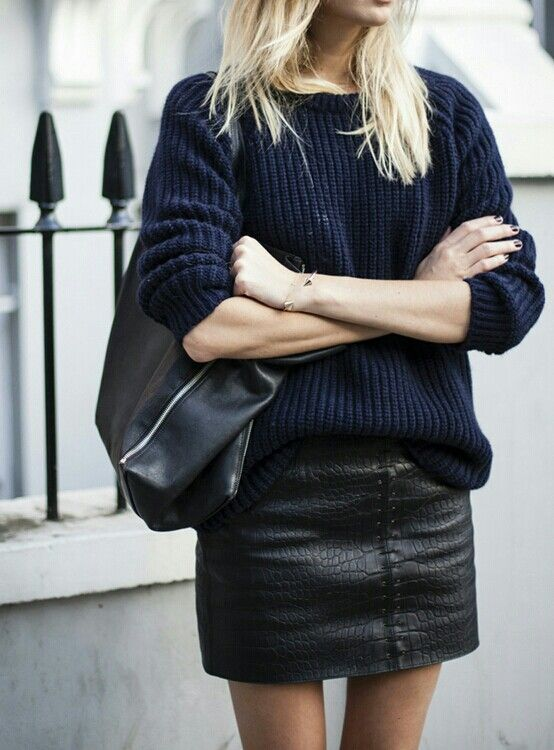 a navy sweater and a black leather textural mini is a chic and sexy combo