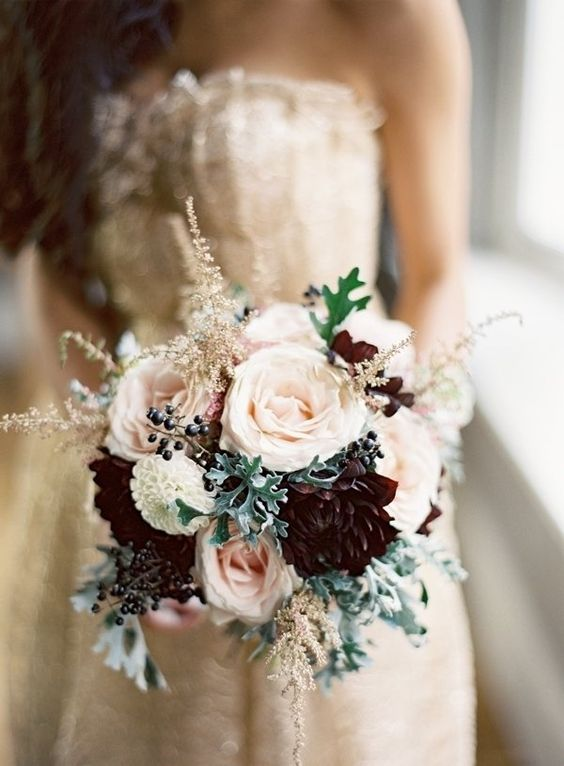 blush wedding bouquet with burgundy blooms, pale millet and privet berries for a romantic look with a moody touch