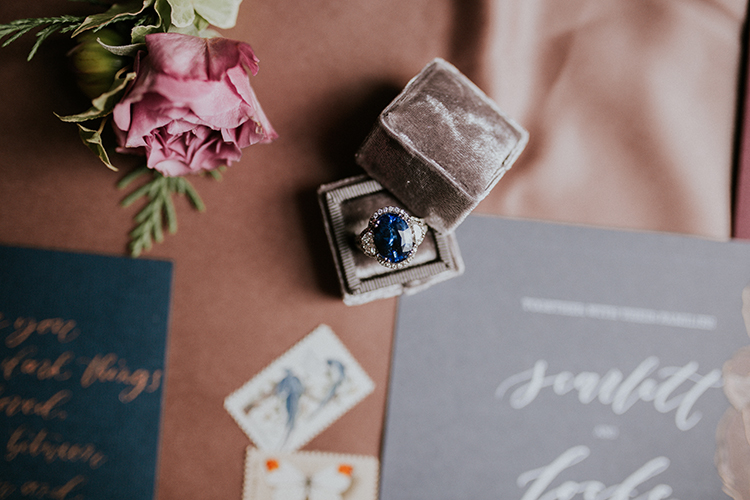 sapphire and diamond engagement rings - http://ruffledblog.com/artist-inspired-wedding-ideas-with-oxblood-and-navy