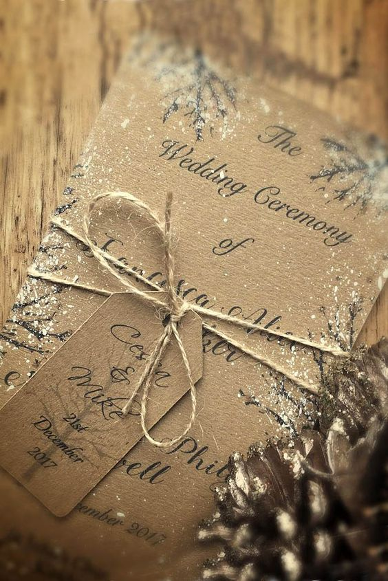 simple cardboard wedding invites with snow and twine look rustic and cozy