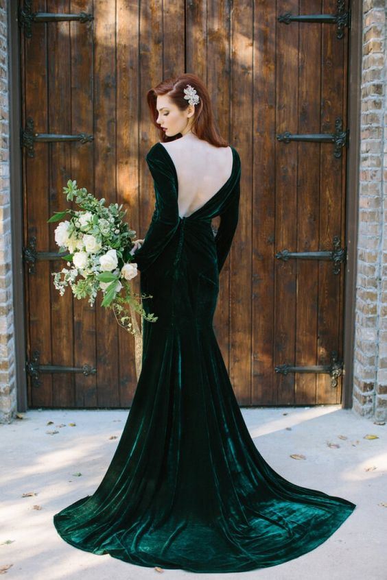 velvet emerald wedding dress with a train, long sleeves and an open back for a daring bride