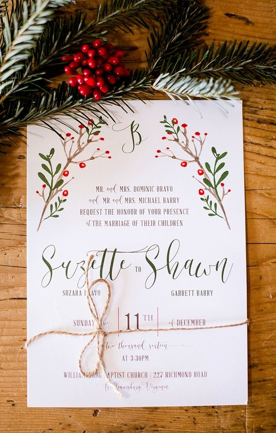 a rustic Christmas wedding invitation with a colorful print in traditional green and red and twine
