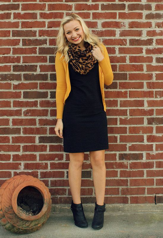 a black dress, a yellow cardigan, black leather booties, a leopard rpint scarf