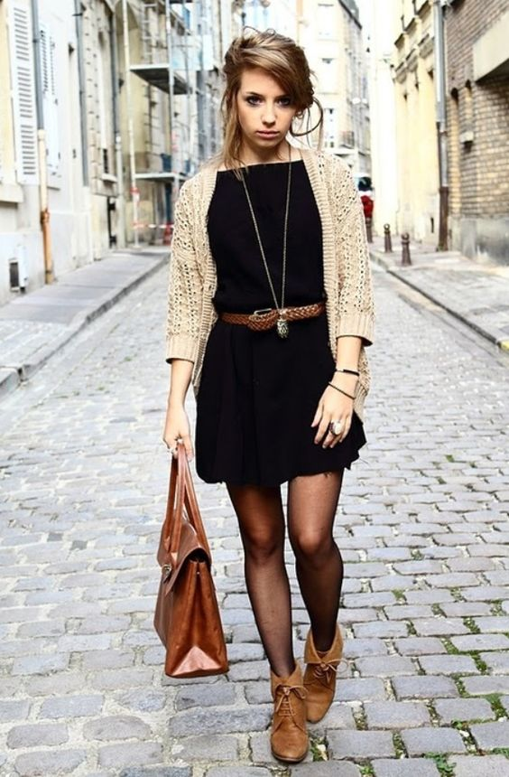 a mini black dress, a neutral cardigan, amber leather booties, a brown leather belt and a matching bag