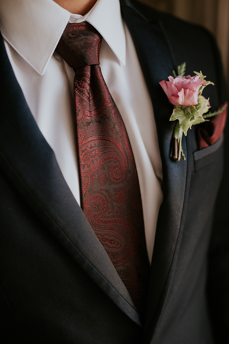red tie groom looks - http://ruffledblog.com/artist-inspired-wedding-ideas-with-oxblood-and-navy