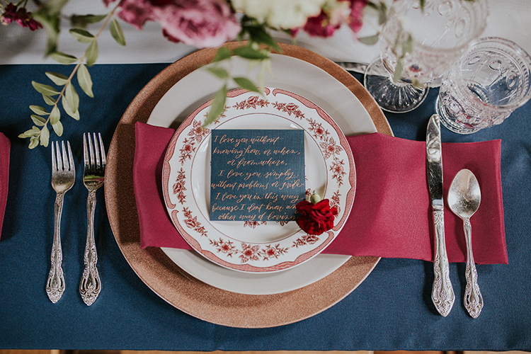 vintage inspired blue and red tables - http://ruffledblog.com/artist-inspired-wedding-ideas-with-oxblood-and-navy