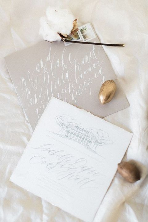 grey and white wedding invites with calligraphy remind of snowy months