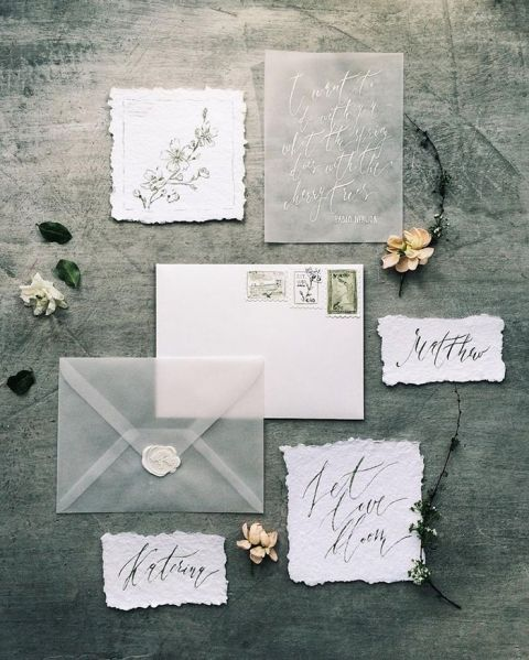 ethereal wedding invitation set in white and grey, with a raw edge, calligraphy and a sheer envelope