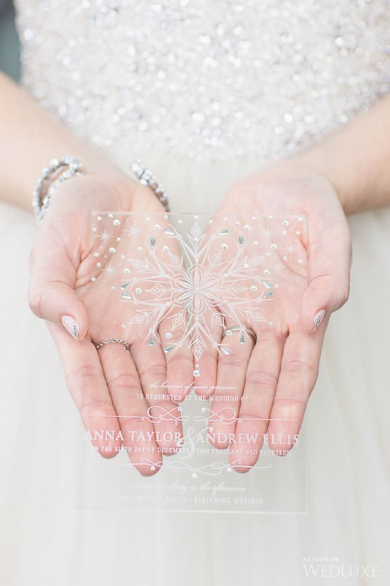 chic sheer acryl wedidng invite with rhinestones, beads and a large snowflake