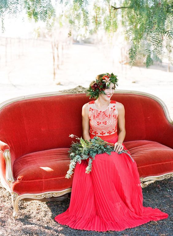 boho-inspired red wedding dress with a detailed bodice and no sleeves