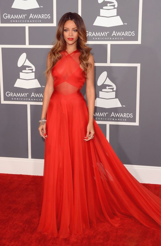 Rihanna inspired everyone with a stunning red dress with a criss cross bodice and a flowy skirt